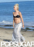 Gwen Stefani's flat belly was likely the talk of the beach in Malibu when she hit the sand in a sexy black bikini in August 2011.