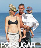 Gwen Stefani wore a black cutout bikini top while walking on the beach in Malibu, CA, with Gavin and Kingston Rossdale in August 2011.
