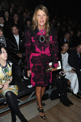 Anna Dello Russo put a hot-pink spin on her lace-embellished sheath at Lanvin. To finish, she complemented the look with a covet-worthy pair of black sandals.