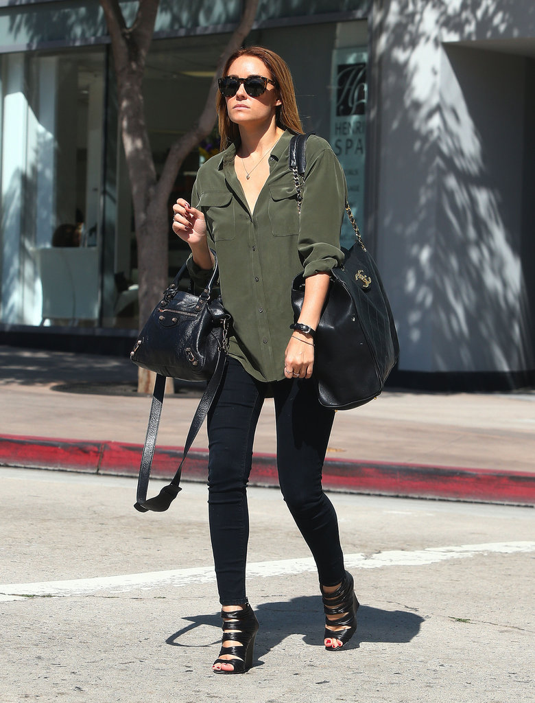 Lauren Conrad headed out in LA in the chicest of city styles — a silky button-up, skinny bottoms, and strappy, cutout wedged booties.