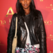 Liya Kebede toughened up a colorful printed skirt with a black leather moto jacket.