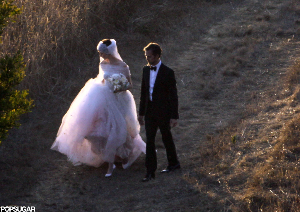 Anne Hathaway picked up her Valentino gown while walking with Adam Schulman in Big Sur.