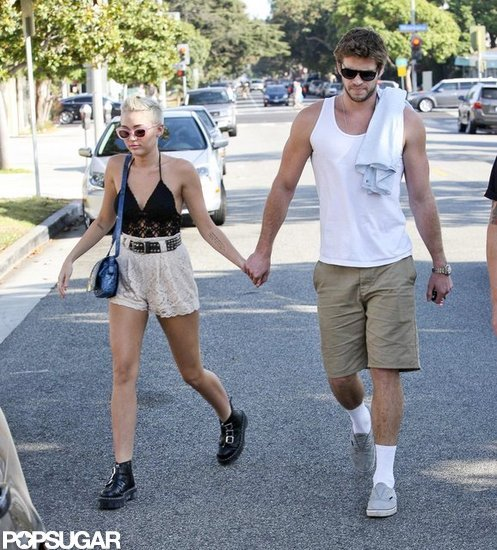 Liam Hemsworth and Miley Cyrus held hands in LA.