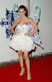Alyssa Milano wore wings to celebrate in LA in 2006.