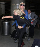 Gwen Stefani had Zuma on her hip at LAX.