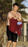 Stephen Moyer slipped on his shirt at the beach.