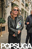 Kate Moss kept warm in a leather jacket.