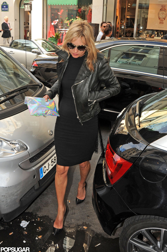 Kate Moss weaved her way through cars.