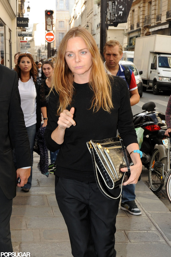 Stella McCartney carried a clutch.