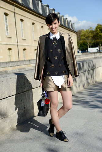 This styler smartly echoed her gilded suiting with the embellishments on her sweater and her brogues.