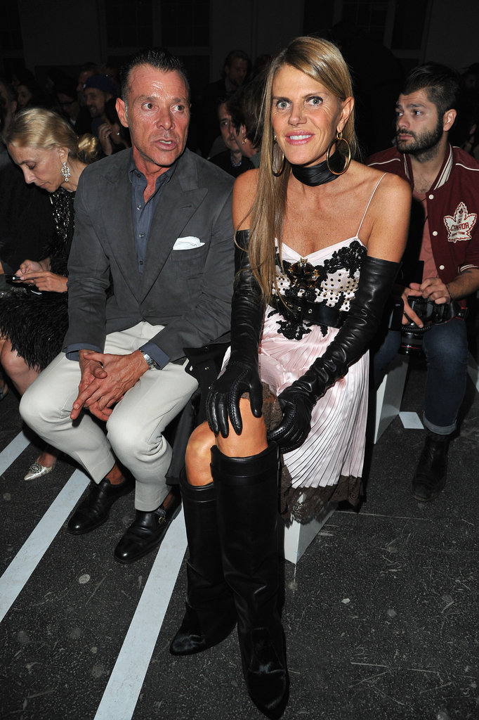 For her Givenchy front-row appearance, Anna Dello Russo put a distinctly vixenish spin on her styling, including Givenchy's sexy boots, a choker, and leather opera gloves.