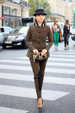 Miroslava Duma switched gears in a button-down tweed suit and a bowler hat — complete with black d'orsay pumps.