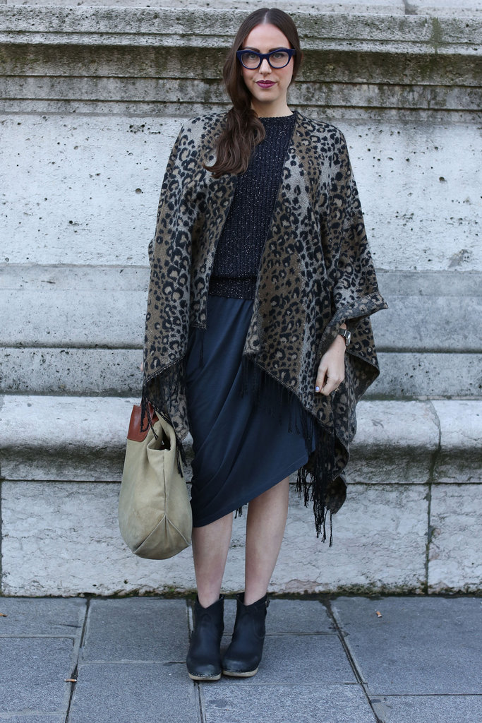 A leopard cape took a navy palette to a more exotic place.