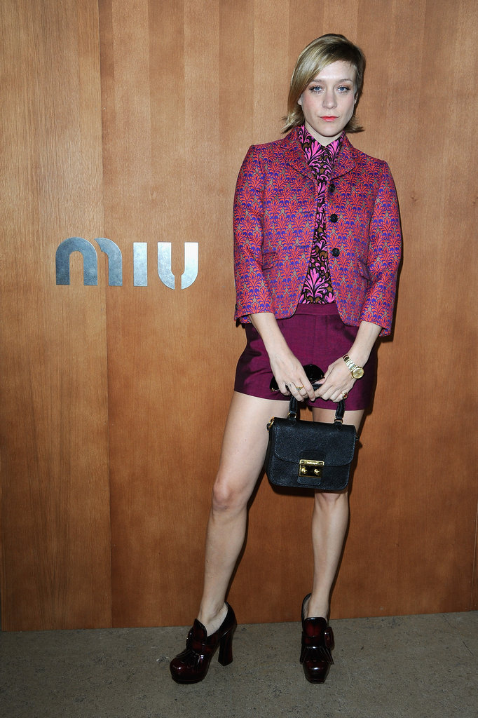 Chloe Sevigny posed before heading into the Miu Miu show during Paris Fashion Week.