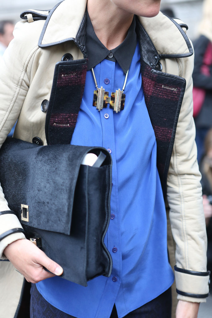 A bookish bag furthered the old-school charm of her trench.