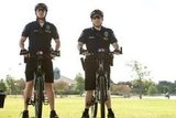 Schmidt and Jenko From 21 Jump Street  What to wear for both: Helmet and bicycle police uniform, complete with shorts and an actual bicycle. How to act: Start carding everyone who's drinking, even if they're definitely of age.