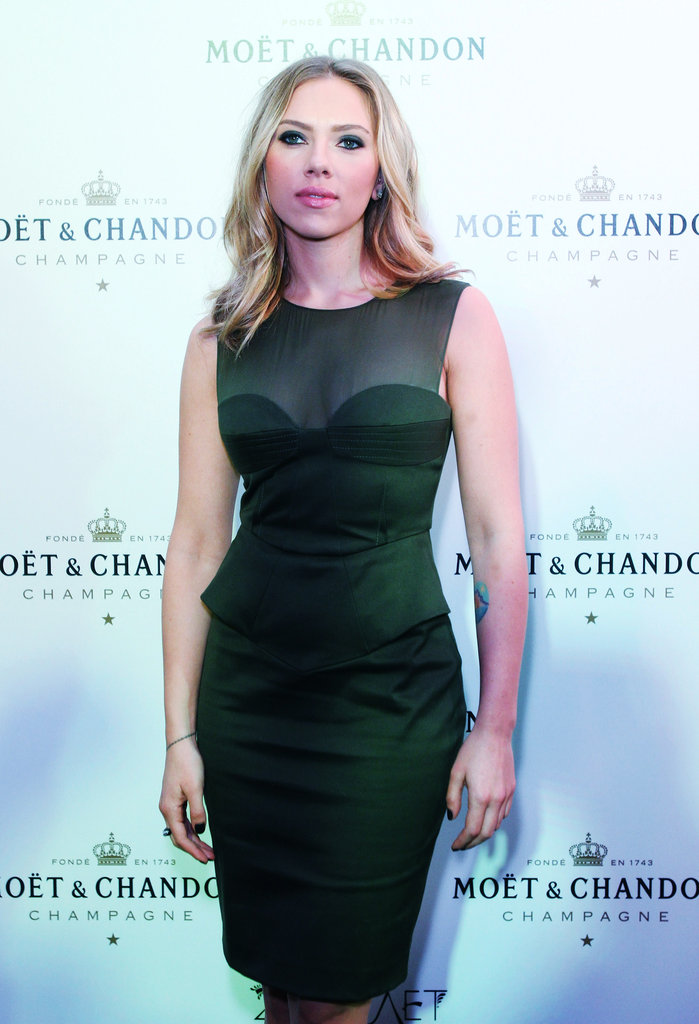 Scarlett Johansson wore a hunter green dress in Moscow.