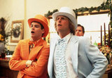 Lloyd and Harry From Dumb and Dumber  What to wear for Lloyd: An orange suit, complete with matching hat and ruffle dress shirt. Don't forget your cane. What to wear for Harry: Same as above, only in powder blue. How to act: Like an idiot, but an idiot who thinks he's really intelligent. Source: Miramax