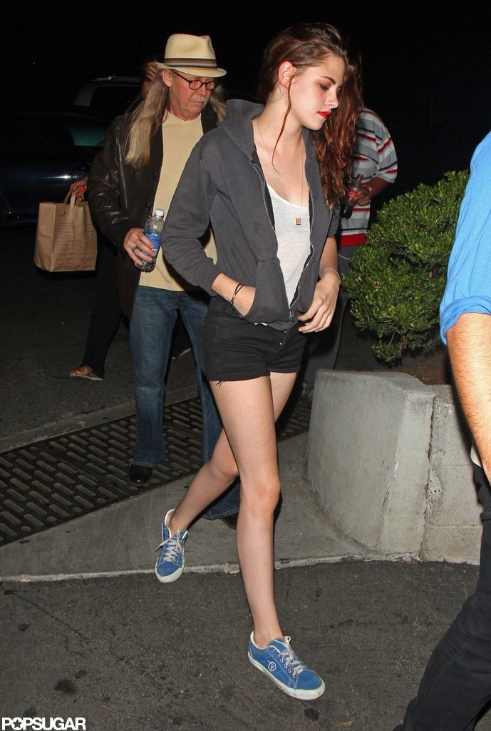 Kristen Stewart showed off her legs in a pair of short cutoffs to attended a Florence and the Machine concert with her dad John Stewart.