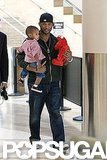 In 2009, Usher arrived at LAX with Usher V and Elmo in tow.
