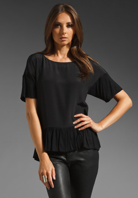 We love the subtle peplum on this Tibi Easy Drop Waist Peplum Top ($198), it's just enough to give a little added interest to a great closet staple.