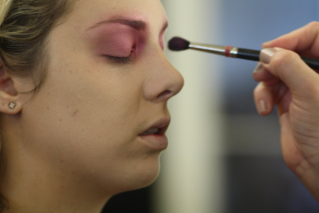 "Using small, circular motions, apply the Fuchsia shade to eyelids and over the brows. ""When you're using multiple colors, start with light colors,"" Zizzo says. ""Then go for the darker ones."""
