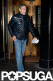 George Clooney left his hotel in Manhattan carrying a script.