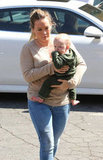 Hilary Duff carried Luca Comrie through a parking lot in Beverly Hills.