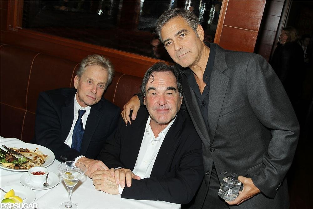 George Clooney and Michael Douglas pose for photos at the NYC screening of Argo.
