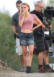 Natalie Portman wore a pink shirt and denim miniskirt for filming in Texas.