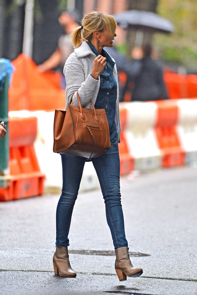 Cameron Diaz wore a denim shirt with a sweater in NYC.