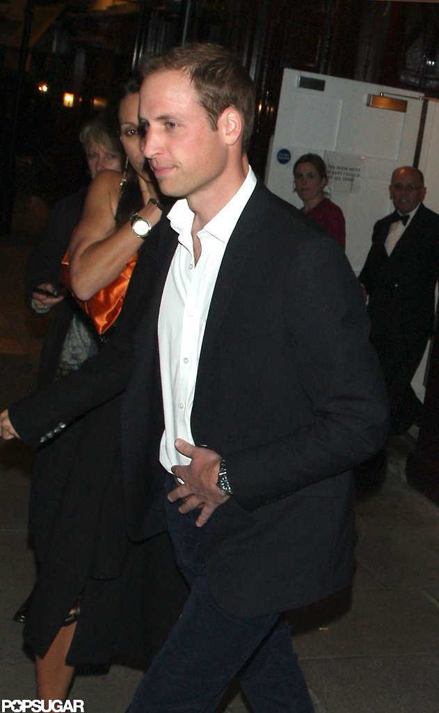 Prince William wore a black suit and white shirt for an evening out in London.