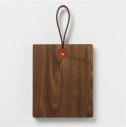 Mimic the beautiful woodgrain countertops in this kitchen by picking up  a Workshop Walnut Serving Board ($168). It can even be displayed on the wall when not in use.