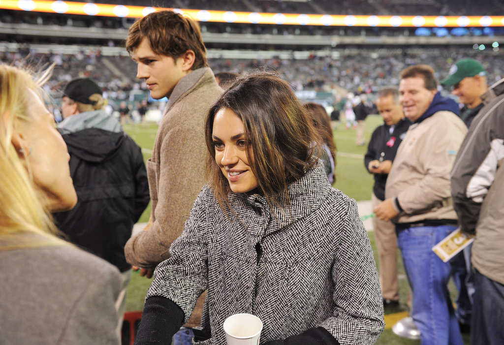 Ashton Kutcher and Mila Kunis went on the field to watch the NY Jets play the Houston Texans.