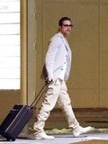 Brad Pitt rolled his suitcase through a French airport.