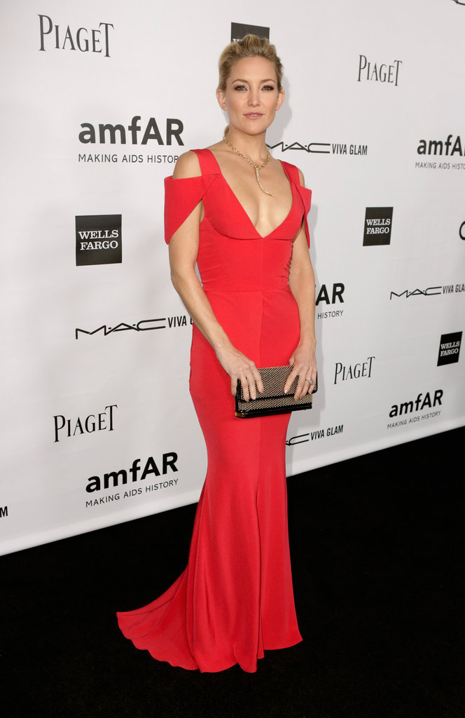 Kate Hudson showed off her svelte curves in red gown by Prabal Gurung, finished off with a gold statement necklace and matching clutch at the amfAR gala in LA.