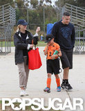Reese Witherspoon wore a baseball cap and carried a bright red bag to Deacon's soccer game with Jim Toth.