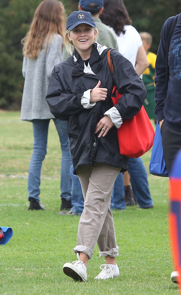 Reese Witherspoon wore a baseball cap and a rain jacket to Deacon's soccer game.