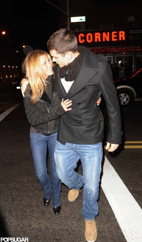 John Mayer and Jennifer Aniston kept warm by cuddling close during the Winter of 2008 in NYC.