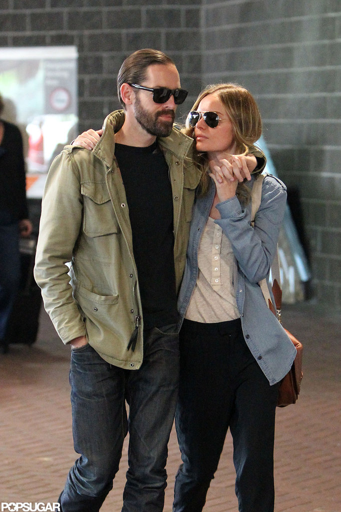 Kate Bosworth and Michael Polish took a sweet stroll through the airport in New Orleans.