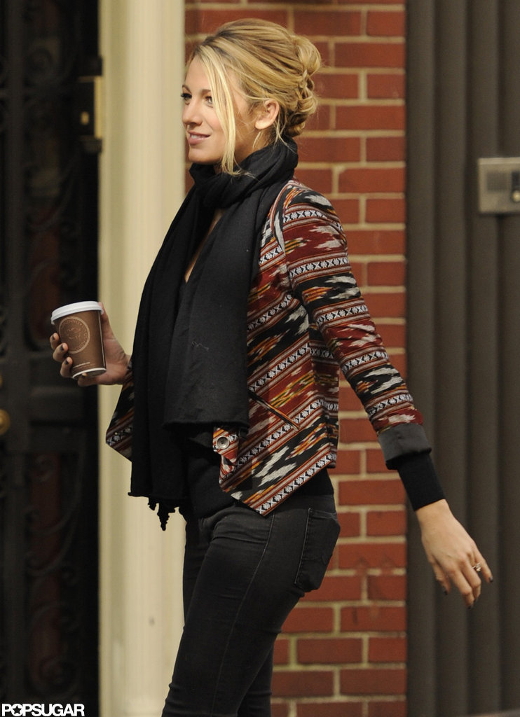 Blake Lively flashed a coy smile on set.