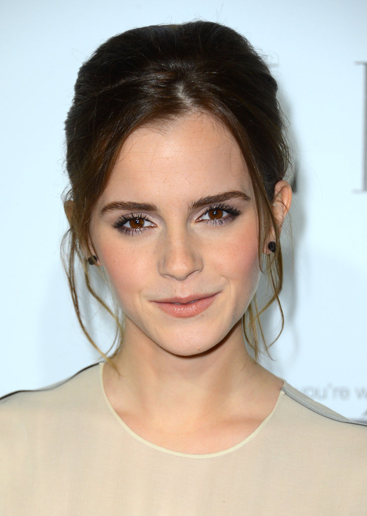 Emma Watson chose a loose up-do for the event.