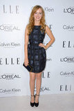 Ahna O'Reilly sported an abstract window-pane-print party dress and ankle-strap pumps.