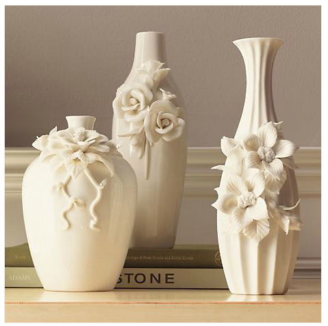 Display Gump's White Floral Vases ($89 for three) on your dresser or mantel for an eye-catching display that looks good with or without fresh flowers.