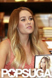 Lauren Conrad held a copy of her book.