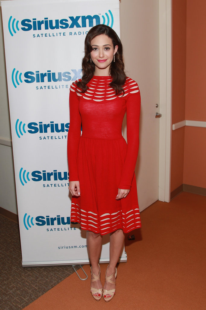 Emmy Rossum wowed in a vivid red Temperley London dress while visiting NYC.