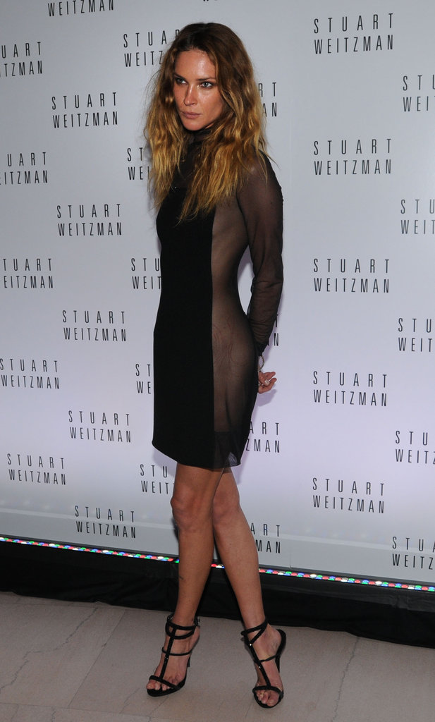 Erin Wasson opted for a sheer black minidress paired with strappy black sandals.