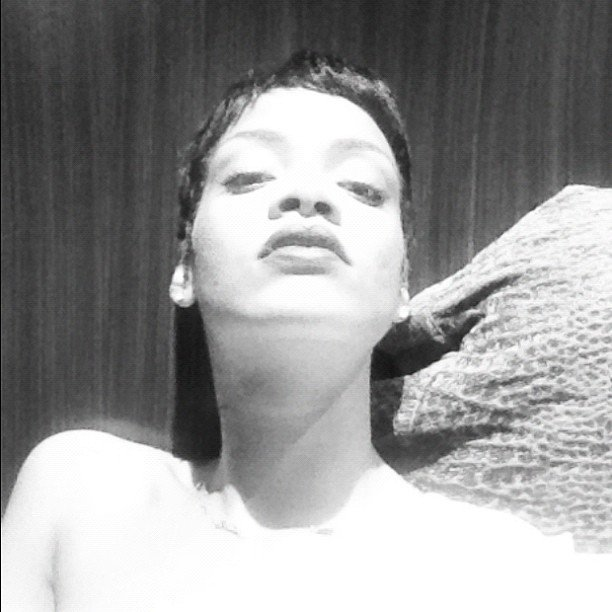 Rihanna took a black-and-white photo in bed. Source: Instagram user badgalriri