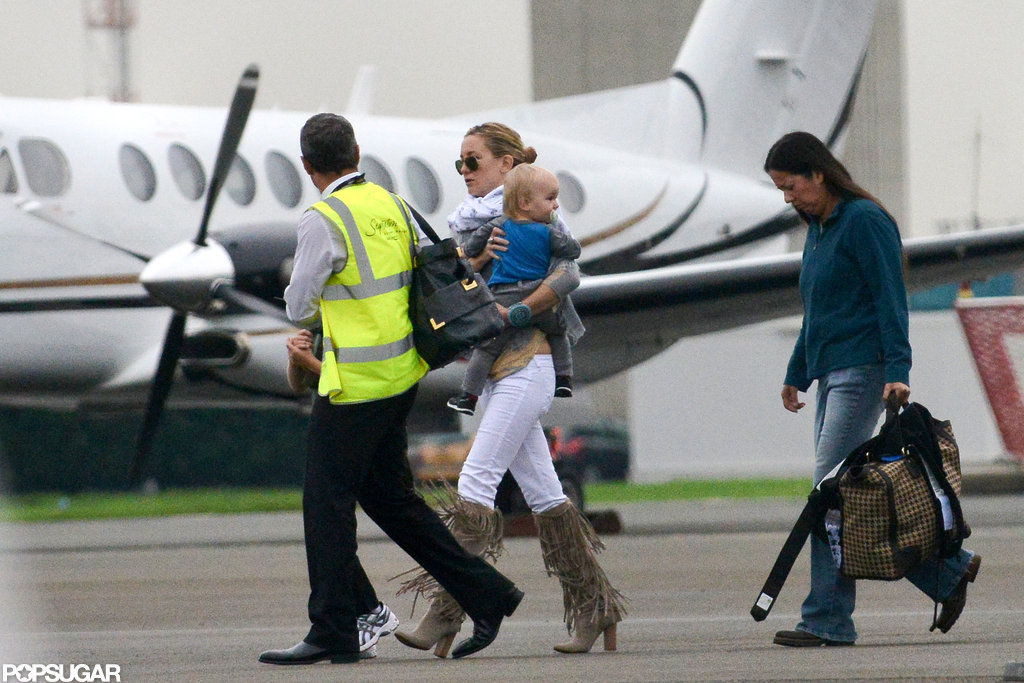 Kate Hudson carried son Bingham Bellamy in LA.