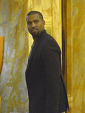 Kanye West looked dapper in a black blazer.